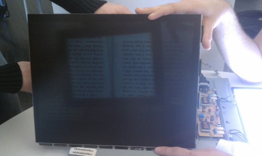 transparent lcd showing a book on the other side